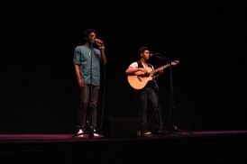 A duo sings and plays guitar at Open Mic.