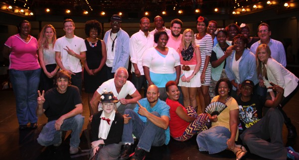 The talented group of performers from July's Open Mic Night pose on McGlohon Theater stage.