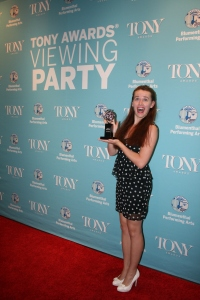 Attendees pose with one of Blumenthal's Tony Awards!