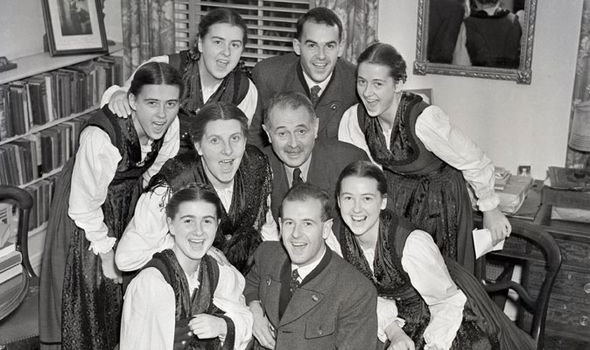 The von Trapp family warming up their vocal chords before a performance