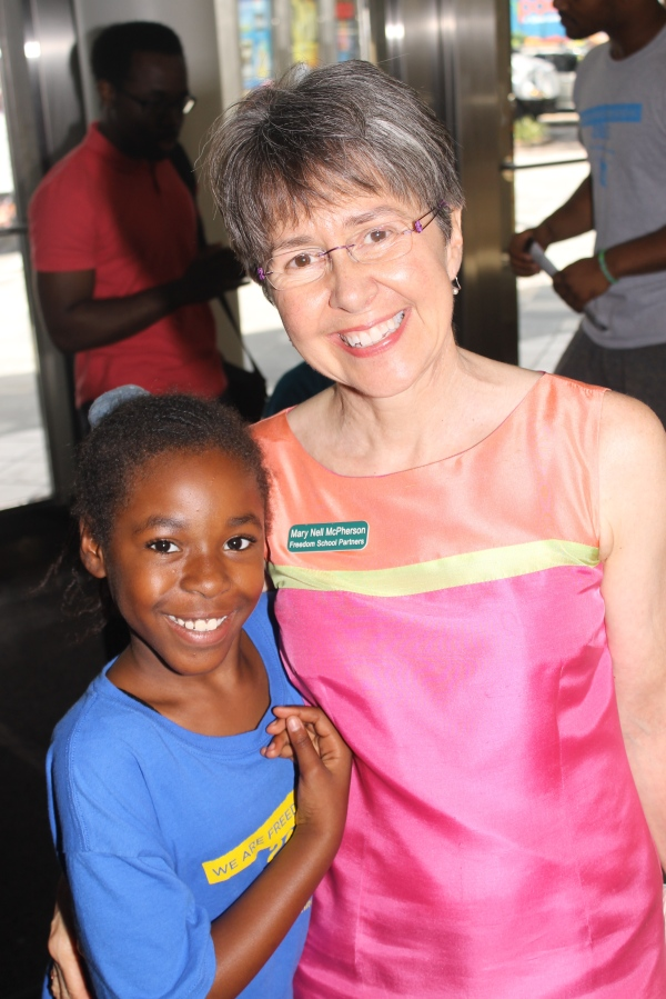 Mary Nell McPherson, Executive Director of Freedom School Partners, with Pinewood Elementary student.