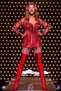 J. Harrison Ghee wears the famous sparkling red boots as Lola. Photo by Matthew Murphy.